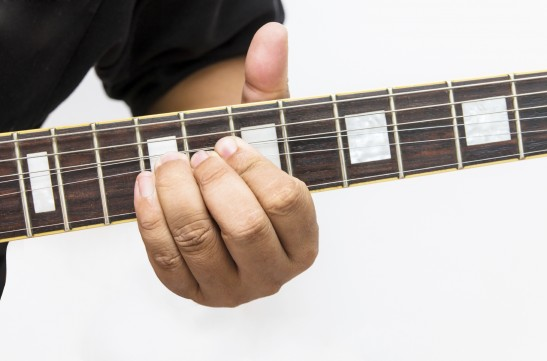 Bending guitar string